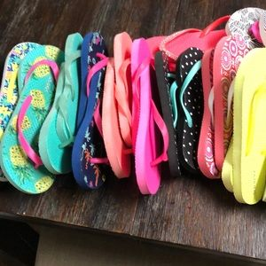 14 pairs of used and new Old Navy flip flops